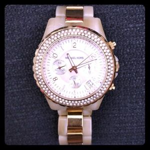 MK watch w yellow gold trim/ mother of pearl face.
